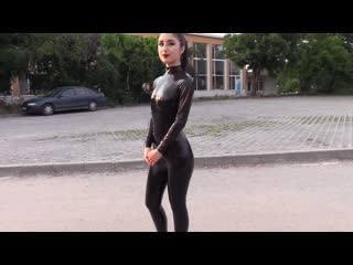 Black latex catsuit and 7 inch high heelsяя