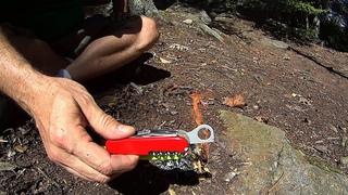 Victorinox SAK Magnifying Lens Firecraft in the Woods.
