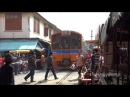 Maeklong Railway Market - Train Runs Through Open Air Market in Thailand