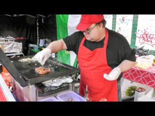 """The """"Pepitos"""" Spanish Sandwich of Marinated Beef, Cheese, Peppers and Mushrooms"""