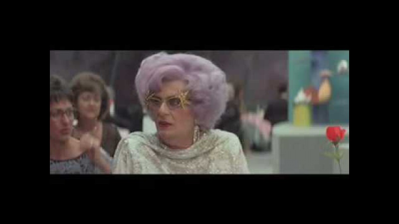 Rotating restaurant scene from Les Patterson Saves The World featuring Dame Edna Everage