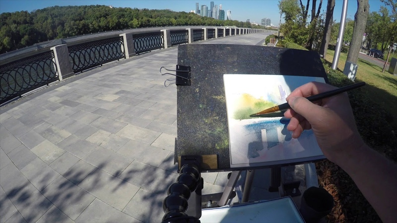 Watercolor urban sketching cityscape with skyscrapers river and embankment