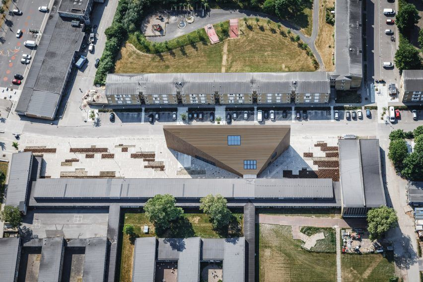 Danish architecture firm COBE has completed the wedge-shaped Tingbjerg Library and Culture House for a school in Copenhagen that narrows to a width of just 1.