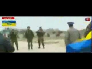 Watch as pro-Russian soldiers fire warning shots at Ukrainian Air Force troops